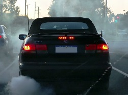 a vehicle emitting smoke